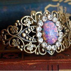 Harlequin Fire Opal Filigree Bracelet. Probably the prettiest opal jewelry I've seen.
