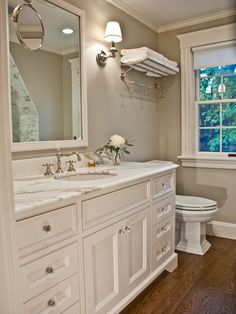 Bathroom - Color Edgecomb Gray, pretty and simple with just a single flower vase, a perfume, and towel rack on top