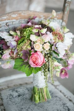 Rustic wild bouquet - garden roses, pieris, sweet peas, clematis, lisianthus, spray roses.   Flowers by Ivie Joy. Photo by J'Adore Love.
