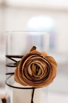 paper rose. wrap stem around vase/candle holder. Lovely!