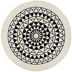 Shop Eclipse Round Black and White Round Rug Graphic celestial circle reminds us of an ancient sundial in deep black and warm ivory. Hand-tufted in a plush blend of Indian and European wools, round rug is super-soft underfoot.