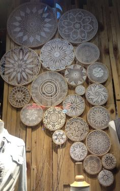 Doilies in embroidery hoops, effective wall art.