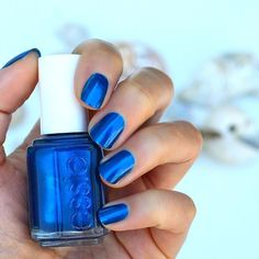 Escape to paradise with this frosty sapphire blue essie 'aruba blue' nail polish. This vacation in a bottle is an essie salon pedicure favorite.
