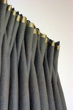 Stunning contrast between this linen drape and the golden green satin trim.