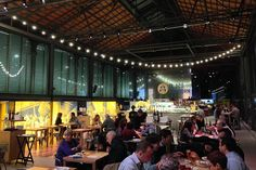 Drinkers at the Mercado del Born. Image by Jo Cooke / Lonely Planet.