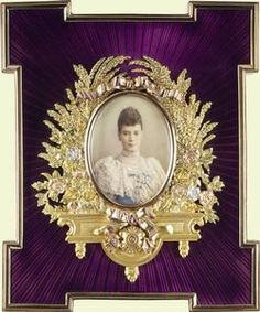 Frame holding a miniature of Tsarina Marie Feodorovna beautifully embellished silver gilt around picture with purple guilloche enamel in the background