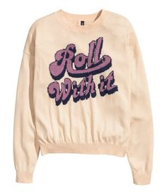 Light peach, fine-knit sweater with vintage-style pink glitter graphic in front. | H&M Pastels