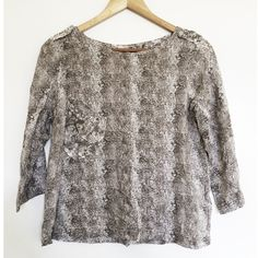 Zara Snakeskin Blouse This Zara Women blouse is a pretty snakeskin print. It has a pocket in front & is a bit wrinkled from being stored in the drawer. Only worn a few times. Zara Tops Blouses