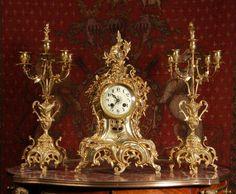 Antique gilt clock and candelabra set  My dad had that clock!!!!!!!