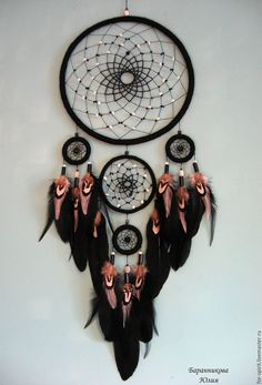 Dreamcatcher, teal instead of pink with some purple in the weaving or wrapping.