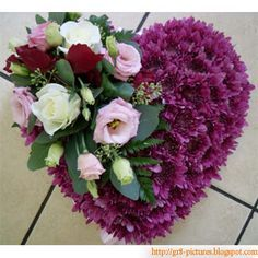 purple heart funeral flowers | The great man is he that does not lose his child's heart...