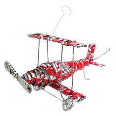 Recycled Tin Strip Red Bi-Plane Handmade and Fair Trade Aluminum Can Crafts, Aluminum Cans, Recycled Gifts, Recycled Materials, Soda Can Crafts, South African Art, Craft Markets, Beaded Animals, Novelty Items