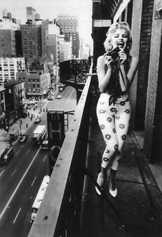 Marilyn Monroe on a balcony at the Chelsea Hotel