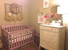 This space is actually my daughter's nursery. I used soft colors of blue, green, pink, purple and gray. I used Annie Sloan chalk paint in Henrietta for the crib and topped it with a silver metallic wax that's also from Annie Sloan