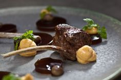 Delicately roasted lamb chops with mushroom jelly and homemade corn purée.