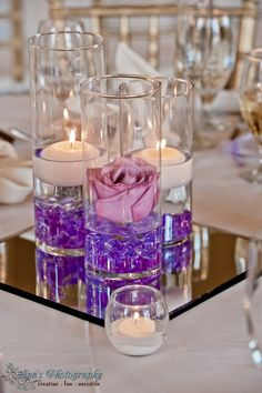 Floating Candle Hurricane Party Decoration Centerpiece Idea. Great for Bar or Bat Mitzvah, Wedding, Sweet 16 or Quinceanera Celebration in Purple, Pink and White.