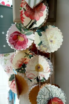 Pretty Paper Garlands | PRISCILLA MAE et al Made from book pictures or wallpaper as well.