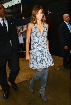 Jessica Alba wears a floral halter mini dress with thigh-high suede boots
