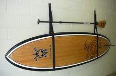 If you don't have the racking space in your garage to store a Stand Up Paddle Board, Strap it Flush on the wall.