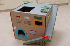 Cardboard garage, can make this for grandkids!!  plenty of boxes at work ;p