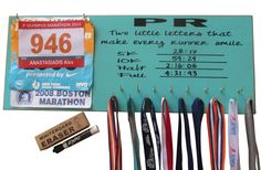 Write your own PR dry eraser medals and race bibs display rack! This is so cool I need this!