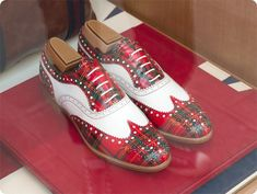 My husband would look dapper in these tartan wingtips