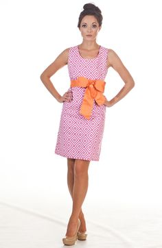 Cute mad men ish bridesmaid dress. Custom made by designer in South Carolina.  Adorable!  Pink and tangerine, but also available in green and navy.