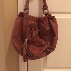 Tan Slouchy Purse Tan, slouchy style purse, a little worn on the handles, two zipper pockets on the front, on big pocket and small zipper pocket on the inside O'Neill Bags Hobos