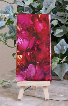 Alcohol ink art red abstract flowers painted on tile