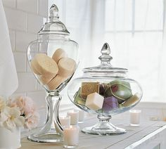 Adding the Accents: Bathroom Decor. Interestingly shaped apothecary glass jars to hold decorative and artisan soaps. For guest bathroom Apothecary Jars Bathroom, Bathroom Jars, Bathroom Spa, Master Bathroom, Bathroom Canvas, Washroom, Bathroom Ornaments, Apothecary Decor, Bathroom Laundry