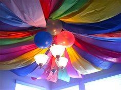 Rainbow theme birthday party - ceiling covered with beautiful colors and balloons