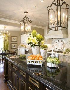 fruit baskets, white w blk accents, some wood w green plants, lantern lights