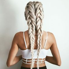 Two is better than one. If you have thicker hair and it's rather hard to keep it all in a single braid, then you can separate them in the middle and then create two braids. Almost like an upgrade of your kindergarten double braided pigtails.