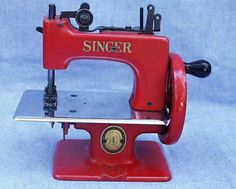 Red Singer Model 20-10 Sewing Machine in the Case     This magnificent red Singer SewHandy comes complete with it's fold-out case and original instruction booklet.  These colored Singers were made for just a short period of time, and this example is in show-it-off condition.    Very Good..........sold for 595.00