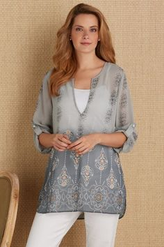 in a sheer dip-dyed fabric, our Mystic Tunic is fashioned with three-quarter sleeves and a cute dropped-tail hem.