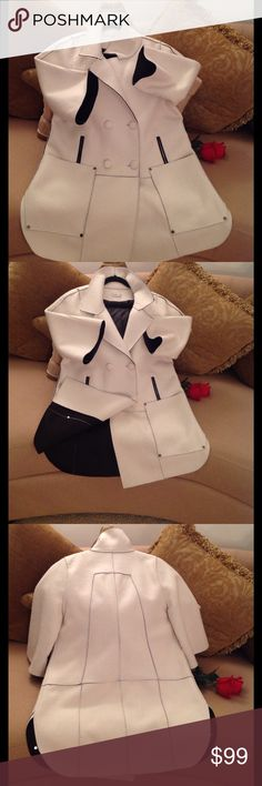 🍃🌹LVD - Winter White Coat 🍃 Stunning Coat!!  Audrey Hepburn inspired White Coat with Black interior/ lining. Extremely Classy and Comfy. Gently worn but is in New Condition. Size Large- Extra Large. 80% Polyester/ 20% Wool. High collar, Big Square Pockets with Silver Nail heads, and covered buttons. Then.....there's the sleeves. Elbow length and Bell shaped. Price is Firm unless bundled 🍃. LVD Jackets & Coats