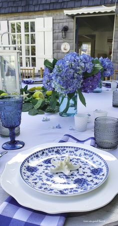 You may remember the table I set there for a dinner party. It was all blue and white with a touch of yellow brought in with lemons. Blue Table Settings, Front Yard Patio, White Lanterns, White Dinner Plates, Blue And White China, Blue Hydrangea, Deco Table, Newport Beach, White Decor