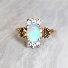 SALE! Vintage 0.75ct Oval Opal and Diamond Heart Valentine's Engagement Ring, 14kt Yellow Gold, Approx 0.18 ctw diamonds, Size 7.25 by RedGingerJewelryCo on Etsy https://www.etsy.com/listing/221783275/sale-vintage-075ct-oval-opal-and-diamond