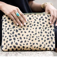 This is a MUST have Clutch and are PERFECT for every season. It ismade from a Leopard Synthetic Fur Design. It features a detachable gold chain strap, oneinsidecompartment and azippered pocket with a top zipper closure. H:8.75 L:12.75 W:1.5 #JessLeaBoutique