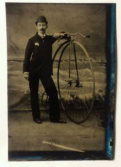 Victorian-bicyclist-posing-with-high-wheel-bicycle-tintype