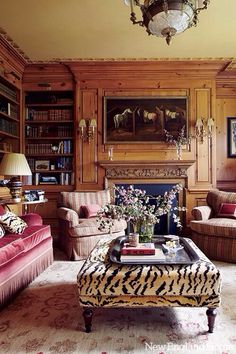 Not the furniture, but the wood paneling, moldings, books & paiting English study