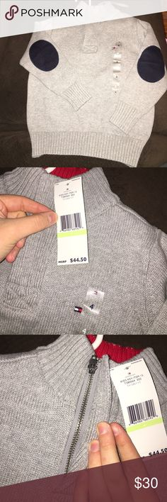 Toddler Boy Tommy Hilfiger Sweater Gray sweater. Size 4. Tommy Hilfiger logo on left side of chest. Navy blue elbow pads. Upper neck area zippers. Brand new, never worn. Perfect condition! 😁 price is negotiable Tommy Hilfiger Shirts & Tops Sweaters