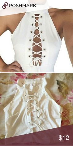 White lace up crop top Size medium. White with lace up center front . Silver grommets . Never worn . Very stretchy.         Sabo skirt inspired Sabo Skirt Tops Crop Tops