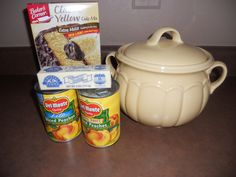 Bean Pot Peach Cobbler  2 small or 1 large can peaches, box yellow cake mix, stick of butter , cinnamon.  In bean pot put in order: peaches with juice, the dry cake mix, pats of butter on top, sprinkle w/ cinnamon. Cover & microwave for appx. 16 mins. serve alone or with vanilla ice cream. Bean Pot 39.00 I didn't have a bean pot, but I used a Pyrex dish...made 8.15.2013 and it is a winner!! Carol