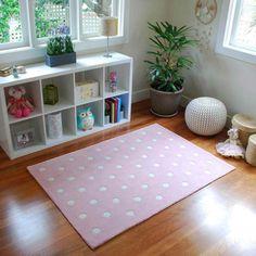 Pink polka dot floor rug.  Super sweet as a nursery rug, girls bedside rug or playroom rug.