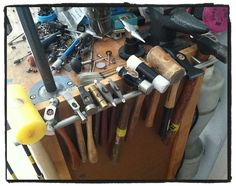 .good use for long cabinet hendle as hammer rack to attach at side of bench.