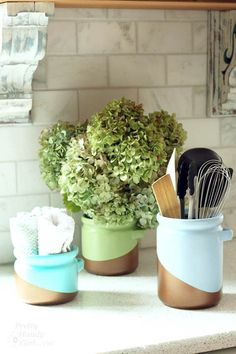 When you get tired of your cobalt blue canisters you can easily spray paint them with a metallic color block pattern.