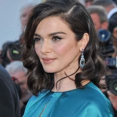Actress Rachel Weisz attended the Cannes premiere of new movie Youth in a floor-sweeping teal Prada gown, accessorised with a pair of sapphire earrings from Chaumet's Lumières d'Eau collection.