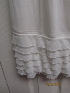 Ivory Ruffle Shirt And dress extender. How clever. Would be easy to make!
