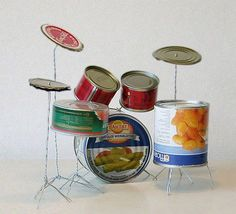 Tin Can Drum Set by Helmut Smits. Year: 2003 Materials: tin cans, metal wire Recycled Art Projects, Recycled Crafts, Art From Recycled Materials, Cd Crafts, Recycling Projects, Recycled Clothing, Recycled Fashion, Craft Projects, Sculpture Art
